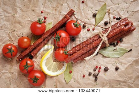 Beef sticks, sausages on a paper background