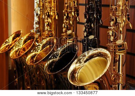 saxophones in storefront in the saxophone store