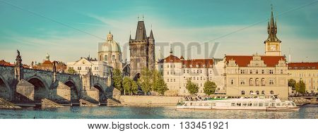 Prague, Czech Republic panorama with historic Charles Bridge. Boat cruise on Vltava river. Vintage