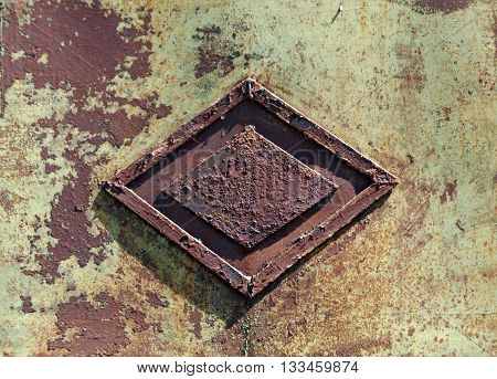 Rusty Metal Gate With Rhombus Decoration.