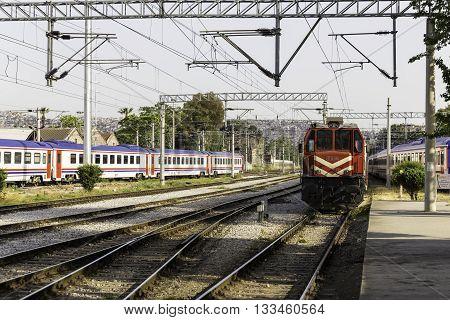 IZMIR TURKEY - APRIL 30 2016: The old red locomotive gasoline-powered train parked in Izmir Alsancak Railway Station which is the second-oldest railway station in Izmir Turkey.