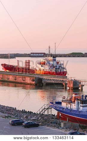 Dry Cargo Vessel At The Marina In Ventspils At Sunset