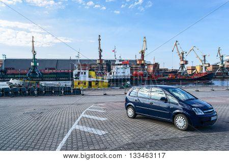 Dry Cargo Vessel And Cranes At Marina In Ventspils