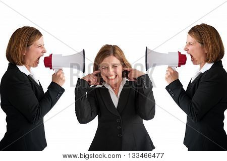 businesswoman being shouted at by businesswomen with megaphone