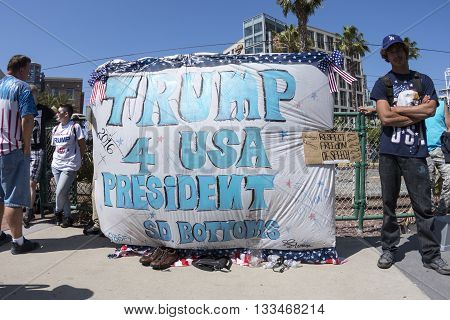 SAN DIEGO USA - MAY 27 2016: Trump supporters display a huge Trump for USA President banner outside a Trump rally at the San Diego Convention Center