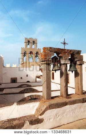 Church and bells on Patmos island Greece. Vertical shot