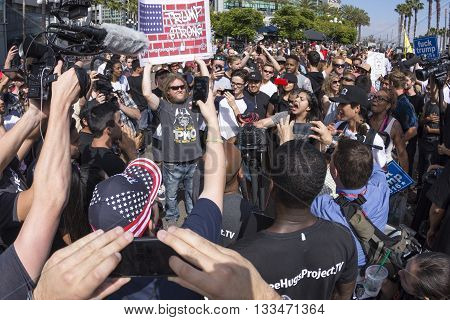 SAN DIEGO USA - MAY 27 2016: Huge groups of protesters clash with Trump supporters in a verbal exchange outside a Trump rally at the San Diego Convention Center.