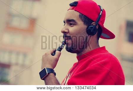 Young Black Man Smoking E-cigarette Vaporizer Device
