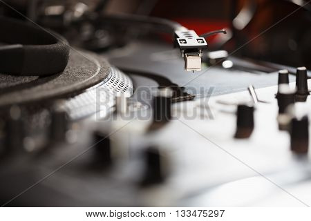Turntable vinyl record player analog sound technology for DJ playing analog and digital music. Close up macro of equipment for professional studio concert event.