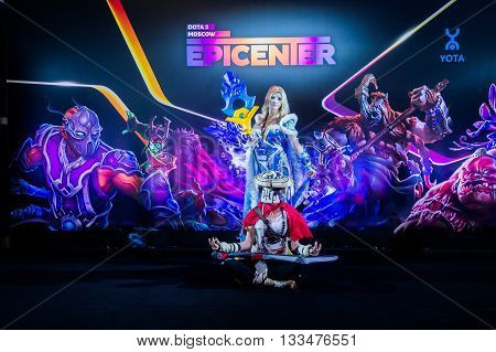 MOSCOW, RUSSIA - MAY 13 2016: EPICENTER MOSCOW Dota 2 cybersport event. Cosplay of game heroes crystal maiden and juggernaut at the event background