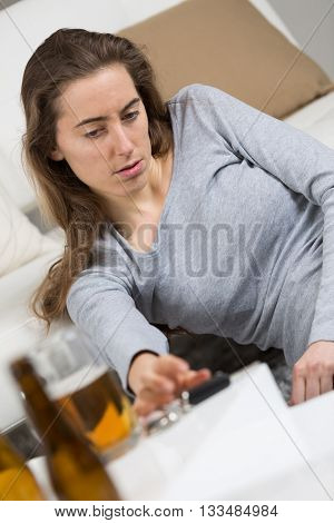 drunk girl holding bottle of beer
