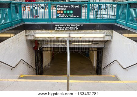 NEW YORK CITY - CIRCA 2016: The entrance to the Chambers Street subway station looks empty in the lower Manhattan area of New York City in 2016. The NYC subway system provides access to Manhattan Queens Brooklyn the Bronx and Staten Island.