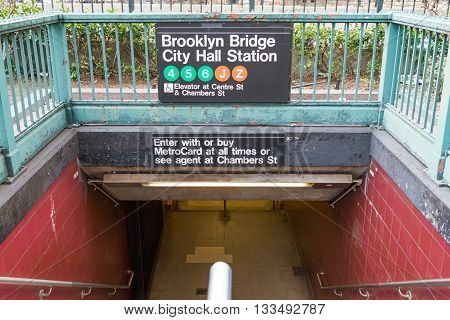 NEW YORK CITY - CIRCA 2016: The entrance to the Brooklyn Bridge City Hall subway station looks empty in the lower Manhattan area of New York City in 2016. The NYC subway system provides access to Manhattan Queens Brooklyn the Bronx and Staten Island.
