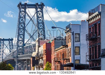 Brooklyn street scene with block of buildings near the Williamsburg Bridge in New York City
