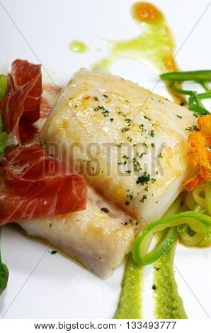 hake fillet  with ham and vegetable sauce