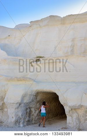 MELOS GREECE - SEPTEMBER 4 2012: Woman walks into one of the old mining tunnels in Sarakiniko.