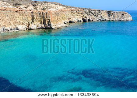 Cape Firiplaka as viewed from Tsigrado cove on the south coast of Melos island in Greece.