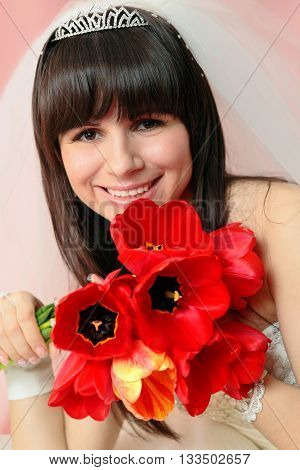 bride with tulips on a homogeneous background
