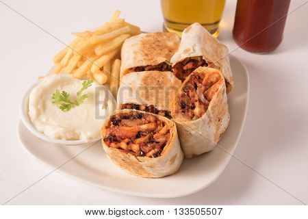 Traditional shawarma wrap with chicken and vegetables
