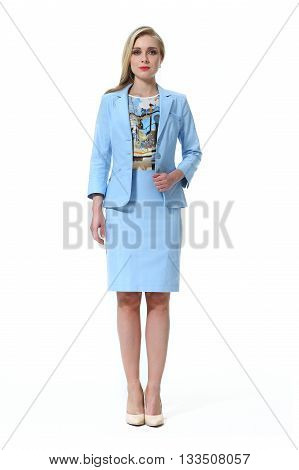 blond slavic business executive woman with straight hair style in official formal skirt suit heel shoes going full body length isolated on white