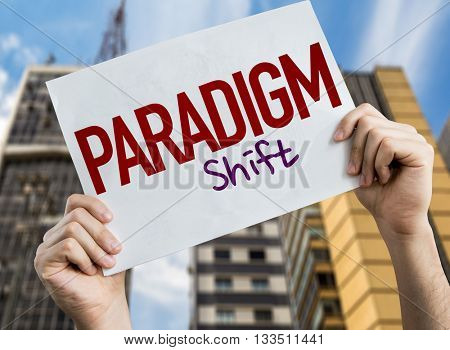 Paradigm Shift placard with cityscape background