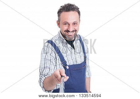 Portrait Of Young Handsome Mechanic In Overalls Using Selfie Stick