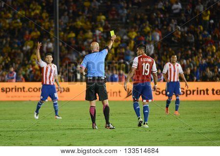 Referee Heber Lopes Shows Yellow Card For Dario Lezcano