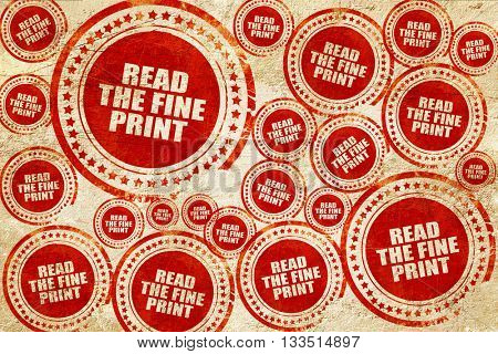 read the fine print, red stamp on a grunge paper texture