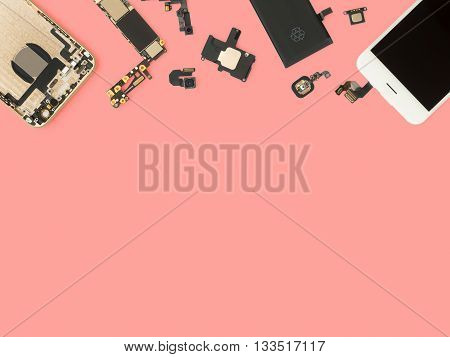 Flat Lay (Top view) of smart phone components isolate on pink background with copy space