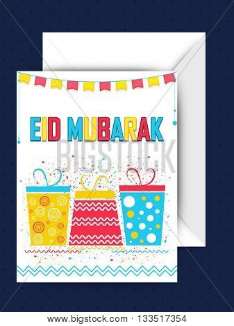 Colourful gifts decorated, Greeting Card with Envelope for Muslim Community Festival, Eid Mubarak Celebration.