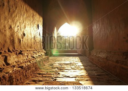 Sunset through an ancient Temple passageway in Bagan, Burma