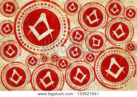 Masonic freemasonry symbol, red stamp on a grunge paper texture
