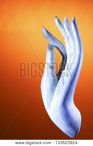 The hand of Buddha in blessing or gift-bestowing gesture , on colorful background with colorful lights .