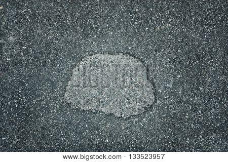 texture old gray asphalt with a hole