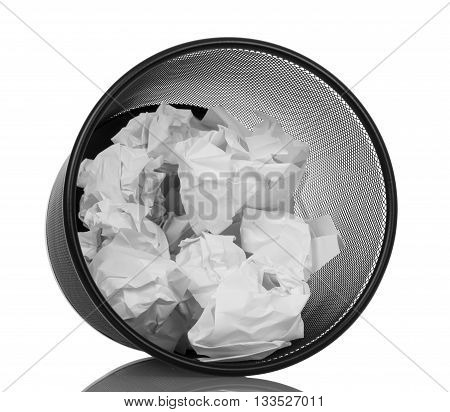 Waste basket with a crumpled paper isolated on white background.