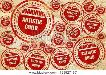 Autistic child sign, red stamp on a grunge paper texture