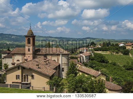 Barolo Wine District and village of Grinzane Cavour with houses and church in province of Piedmont Italy.