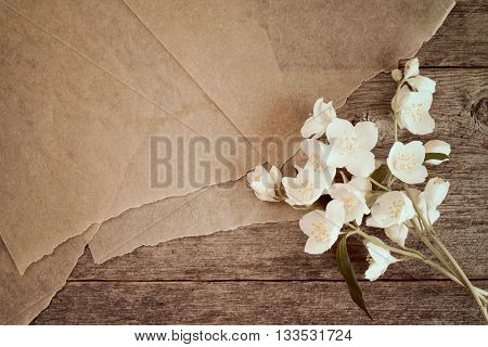 Wild flowers with piece of old paper for your text