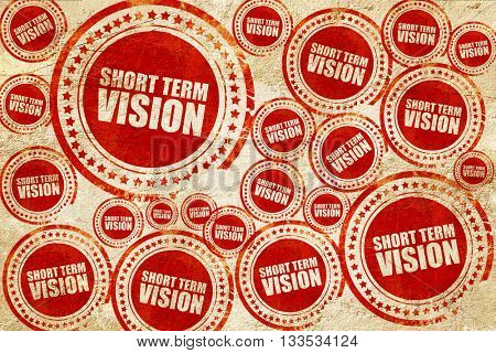 short term vision, red stamp on a grunge paper texture