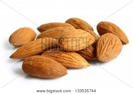 Pile Of Whole Almonds Isolated On White.