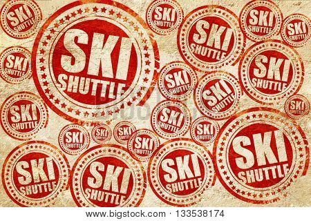 ski shuttle, red stamp on a grunge paper texture