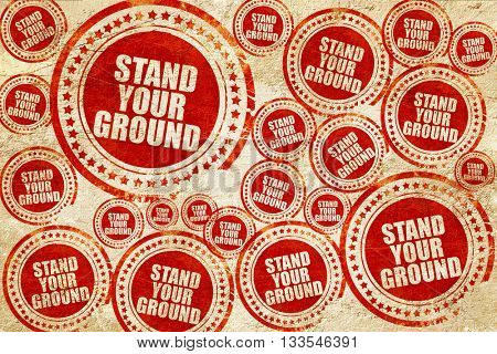 stand your ground, red stamp on a grunge paper texture