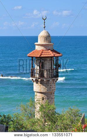 Minaret of old Jaffa mosque and Mediterranean Sea. Israel.