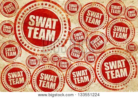 swat team, red stamp on a grunge paper texture