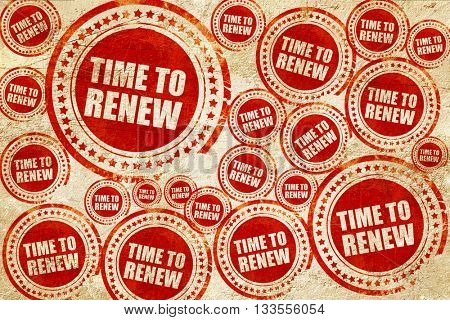 time to renew, red stamp on a grunge paper texture