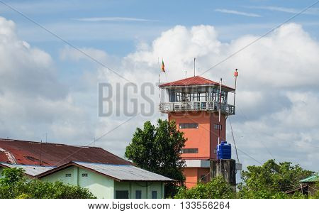 Airport control tower in Myeik Myanmar one several small airports all over the country. Due to its lacking road and railway infrastructure Myanmar relies heavily on air transport for people to get between cities.