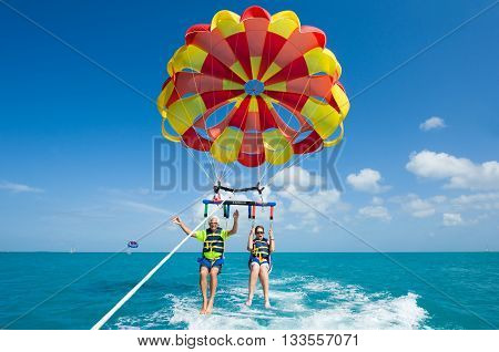 KEY WEST FLORIDA USA - MAY 02 2016: An elderly couple is para sailing with a rope pulled by a boat near Key West in Florida
