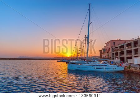 Old harbour with fishing boats and marina of Chania at dawn, Crete, Greece
