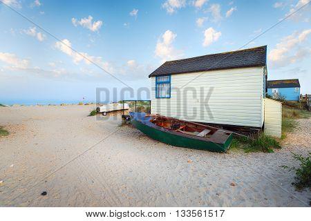 Boats and beach huts at Mudeford Spit near Christchurch in Dorset