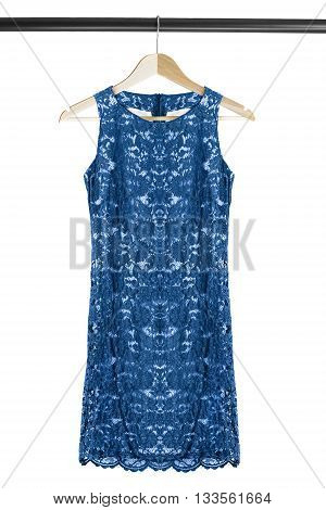 Blue lacy dress on clothes rack isolated over white